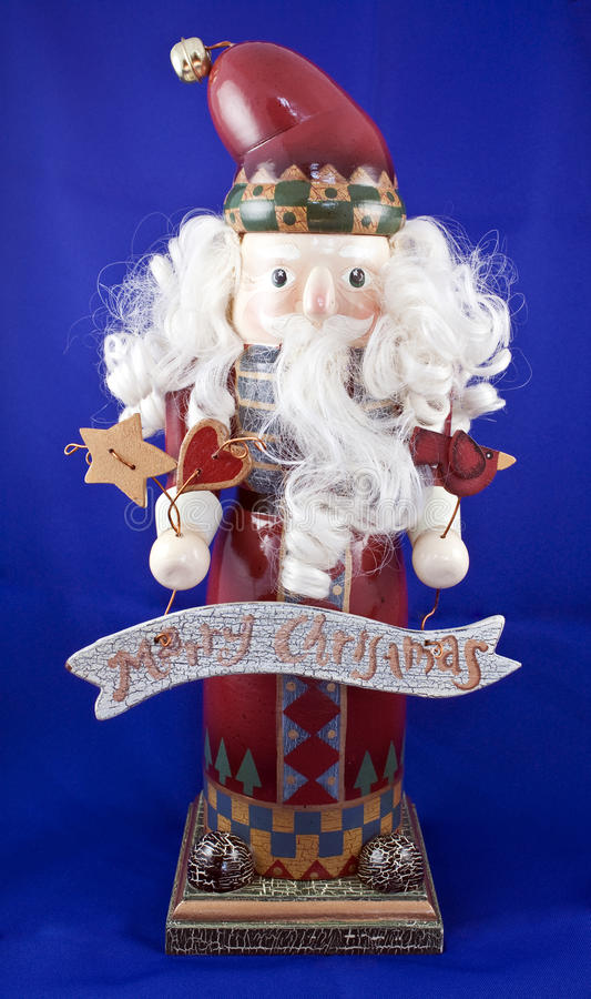Santa Claus isolated. On a blue background with white hair, hearts, stars, and a Merry Christmas plaque stock photos