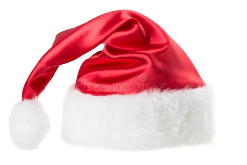 Santa Claus kapelusz ustawia odosobnionego na białym tle obrazy stock