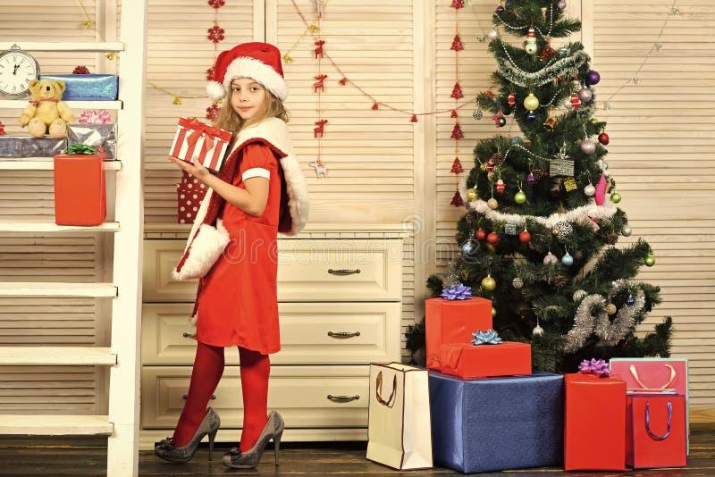 Santa claus kid at Christmas tree. royalty free stock photo