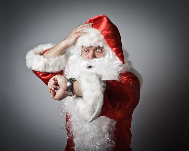 Santa Claus is laat stock foto