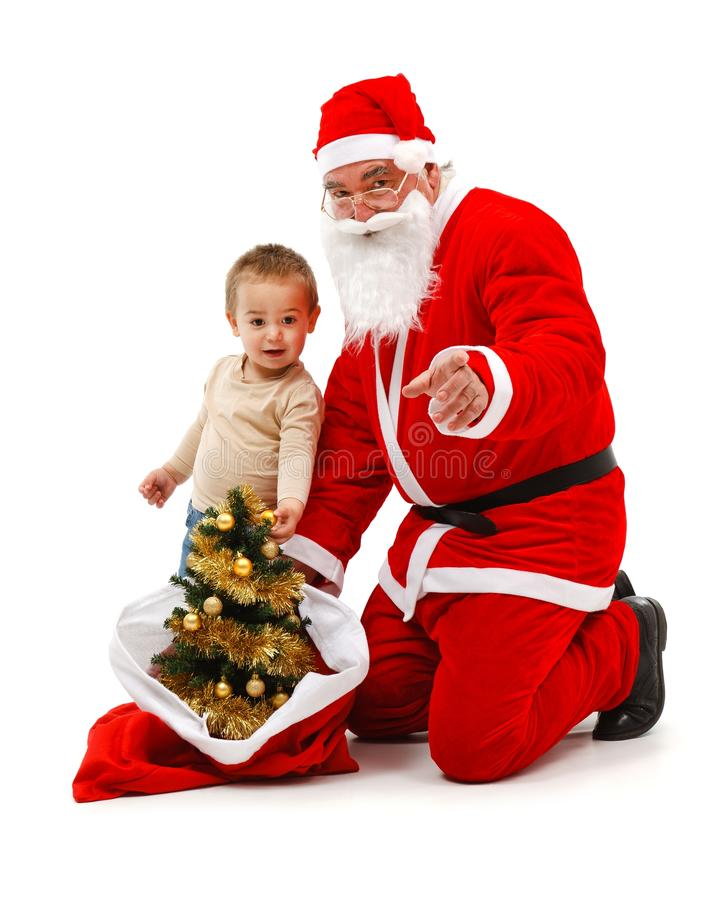Santa claus and little boy looking at us stock photography