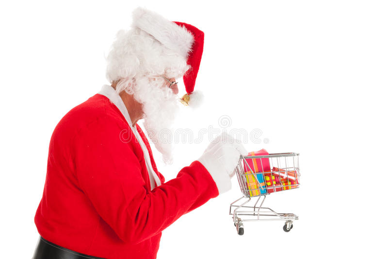 Santa Claus with little shopping cart. Gifts in recession time stock images