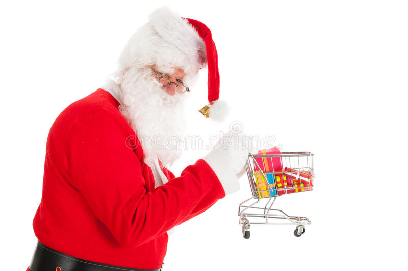 Santa Claus with little shopping cart. Gifts in recession time stock photos