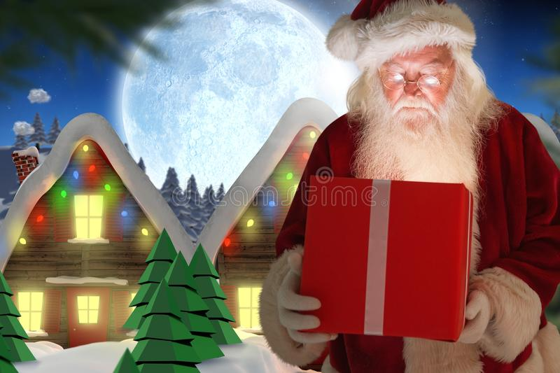Santa claus looking at christmas gift. Against digitally generated background stock photos