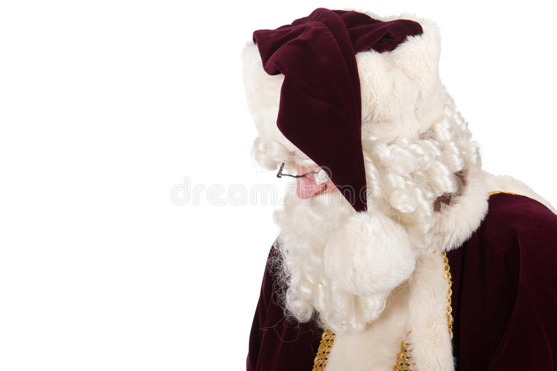 Santa Claus looking down. Isolated over white background stock image