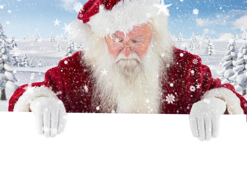 Santa claus looking down at white placard 3D royalty free stock images