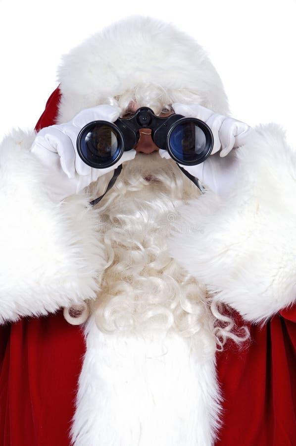 Santa Claus lornetki obraz stock