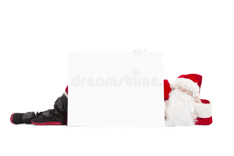 Santa Claus lying with blank banner. Happy Santa Claus lying with blank banner royalty free stock photos