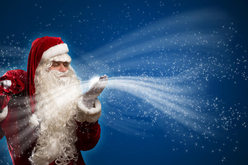 Santa Claus and the magic royalty free stock photos