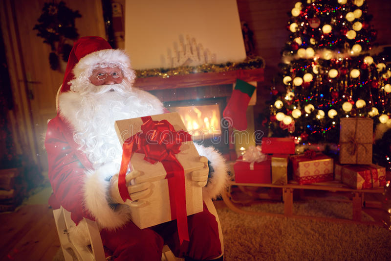 Santa Claus with magical gift for you royalty free stock photo