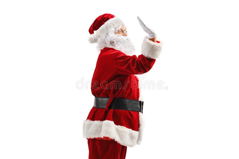 Santa Claus making high-five gesture royalty free stock photography