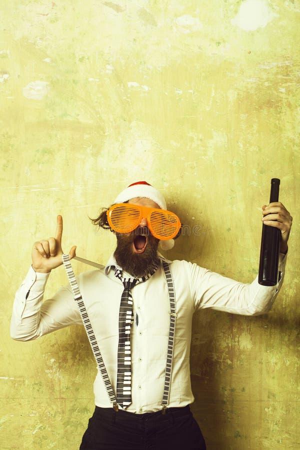 Santa claus man with wine bottle. stock image