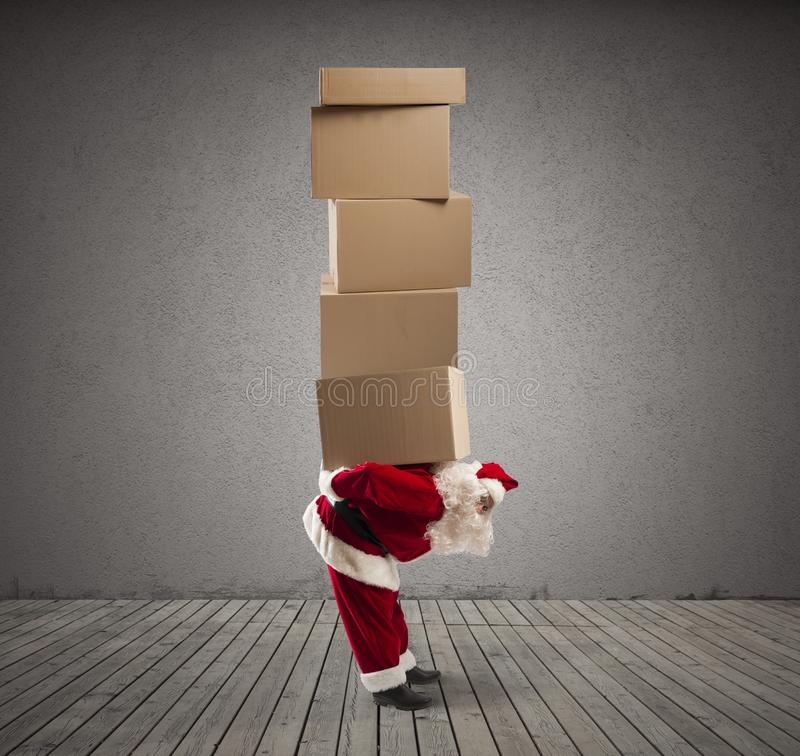 Santa Claus with many gifts royalty free stock photography