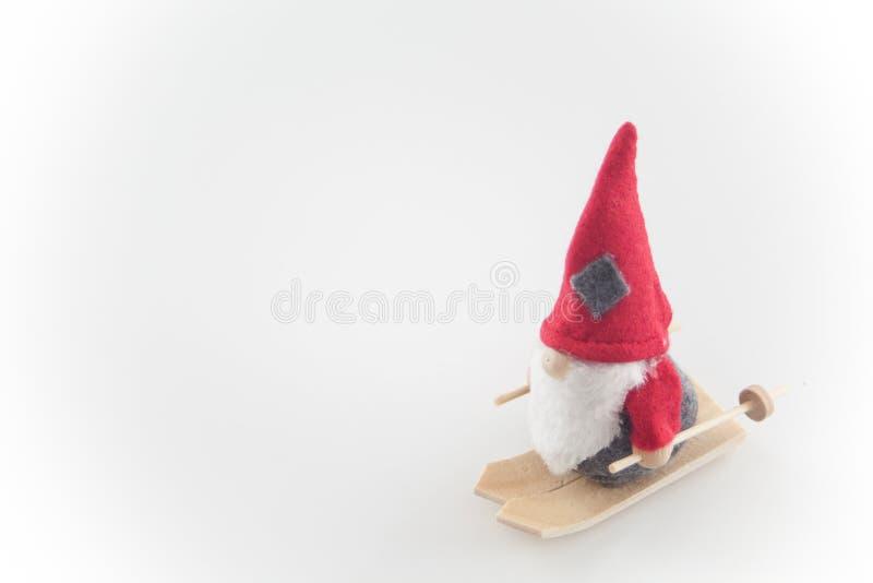 Santa Claus-Marionette auf Skis, Holzwollen stockbilder