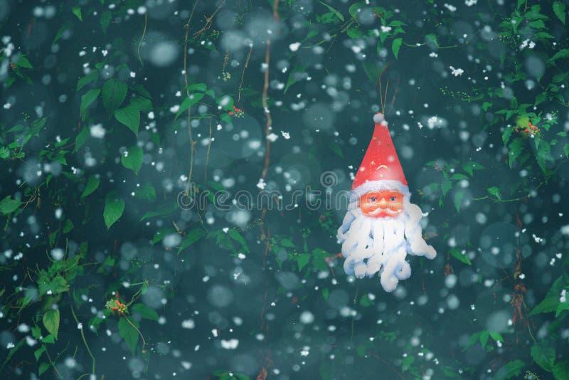 Santa Claus Mask in snow. Christmas decoration. royalty free stock photos