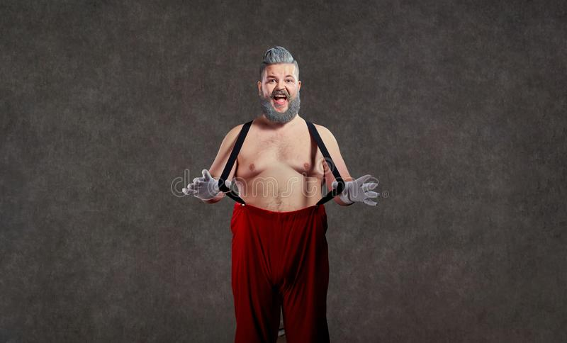 Santa Claus med en naken buk arkivbild