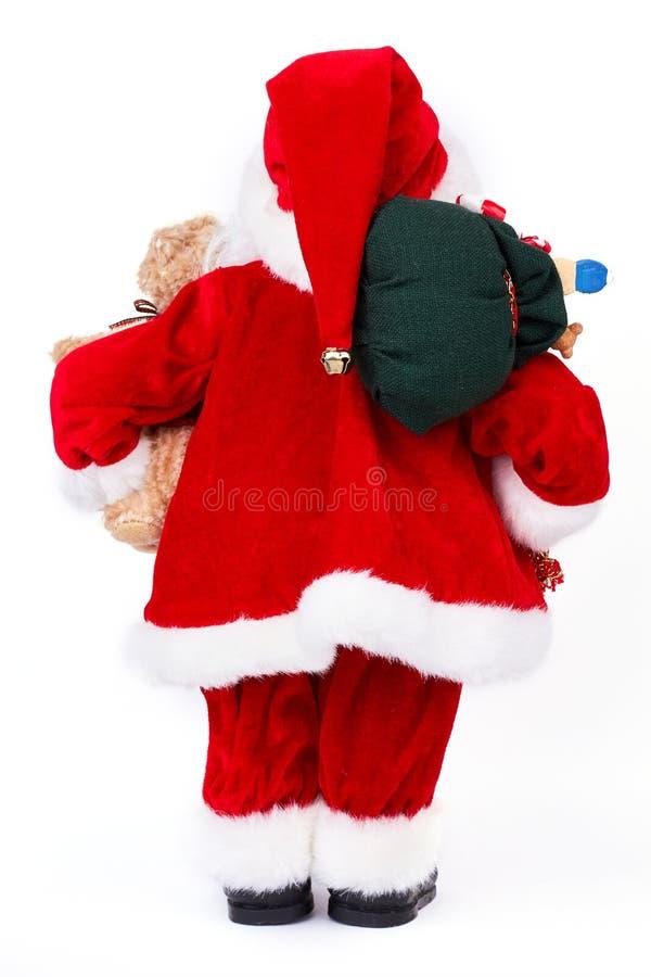 Santa Claus med julgåvor, baksidasikt royaltyfri bild