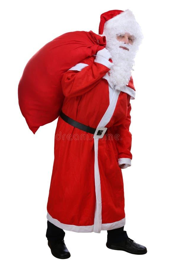 Santa Claus med påsen för isolerade julgåvor arkivbild