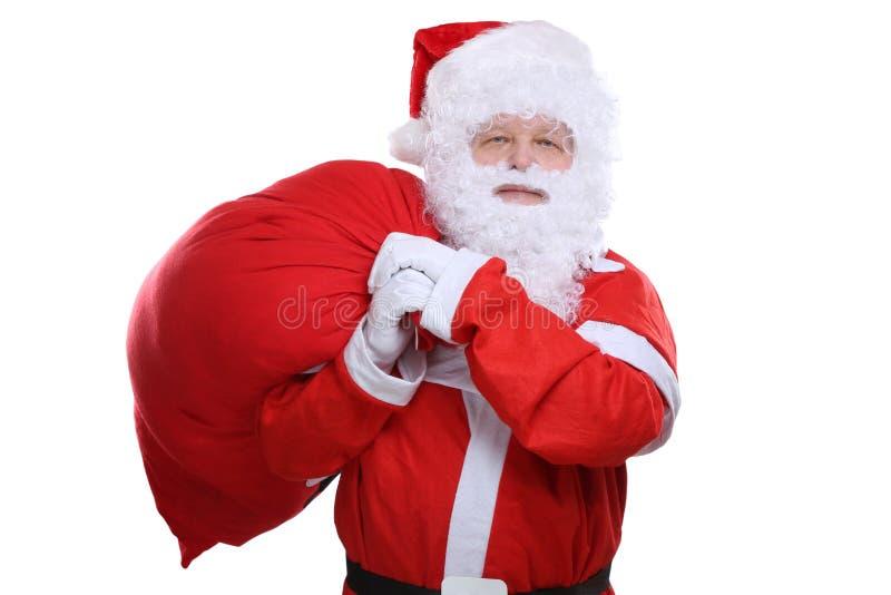 Santa Claus med påsen för julgåvor som isoleras på vit royaltyfri bild