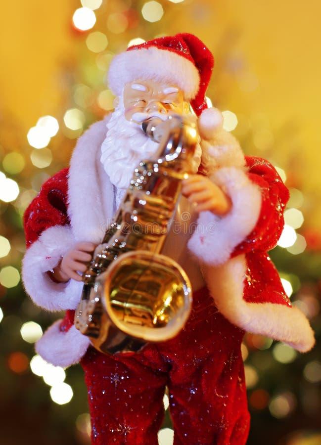 Santa Claus med saxofonen arkivfoton