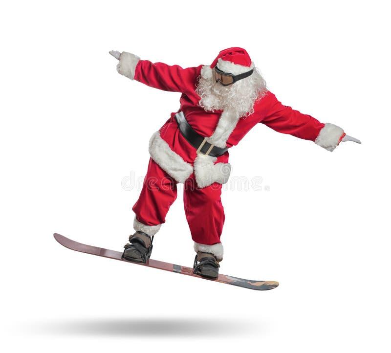 Santa Claus med snowboarden royaltyfri fotografi