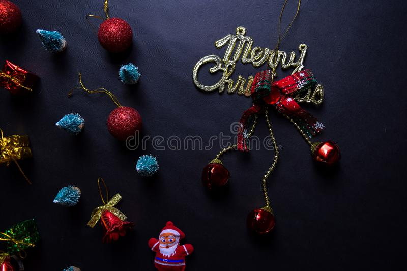 Santa Claus, merry christmas text and Decorative Christmas isolated on black background stock photography