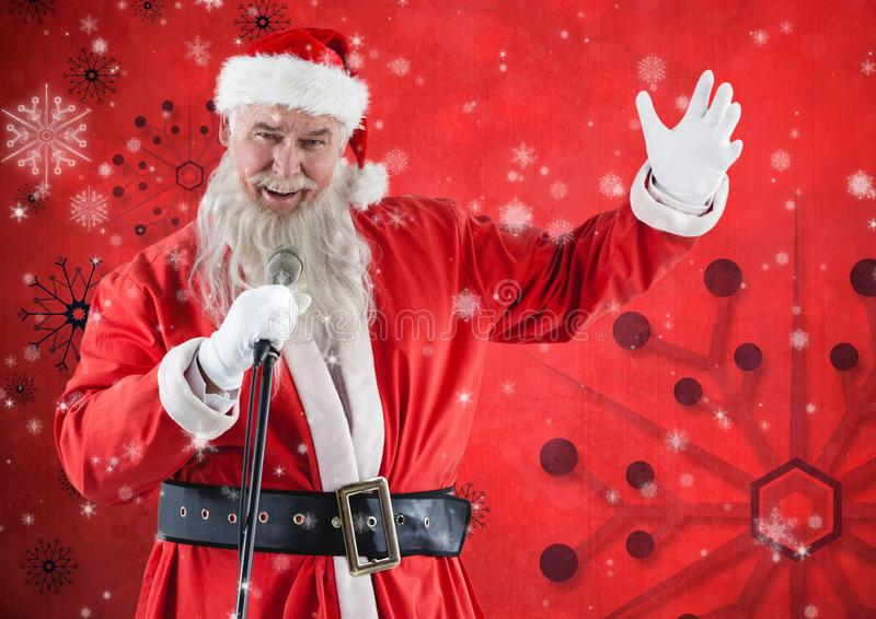 Santa claus with a microphone singing christmas songs. Rear view of santa claus with a microphone singing christmas songs against red background stock images