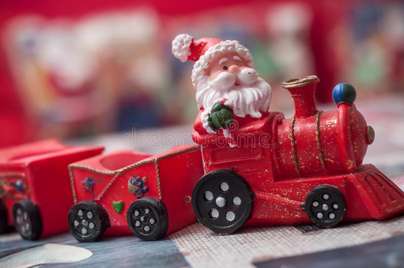 Santa claus on miniature toy train royalty free stock photography