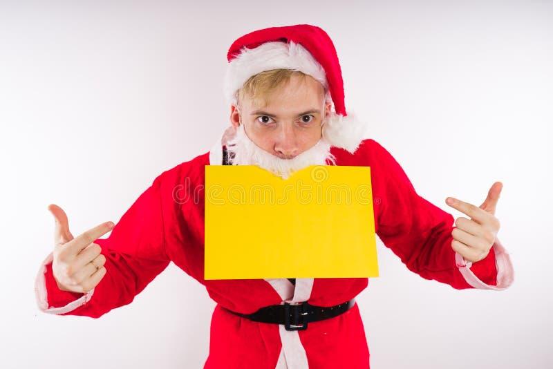 Santa Claus mit einem Zeichen auf einem weißen Hintergrund Das Konzept von Rabatten und von Verkäufen für Weihnachten Leerer Plat lizenzfreie stockfotografie