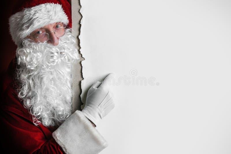 Santa Claus mit großer leerer Karte lizenzfreie stockfotografie