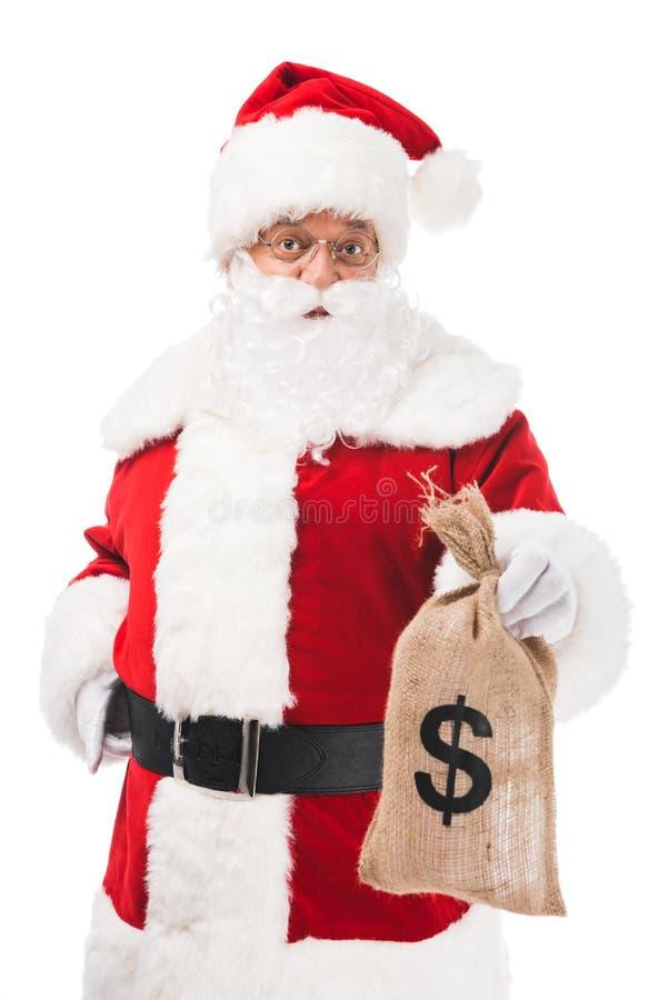 santa claus holding sack bag with money and looking at camera royalty free stock photos