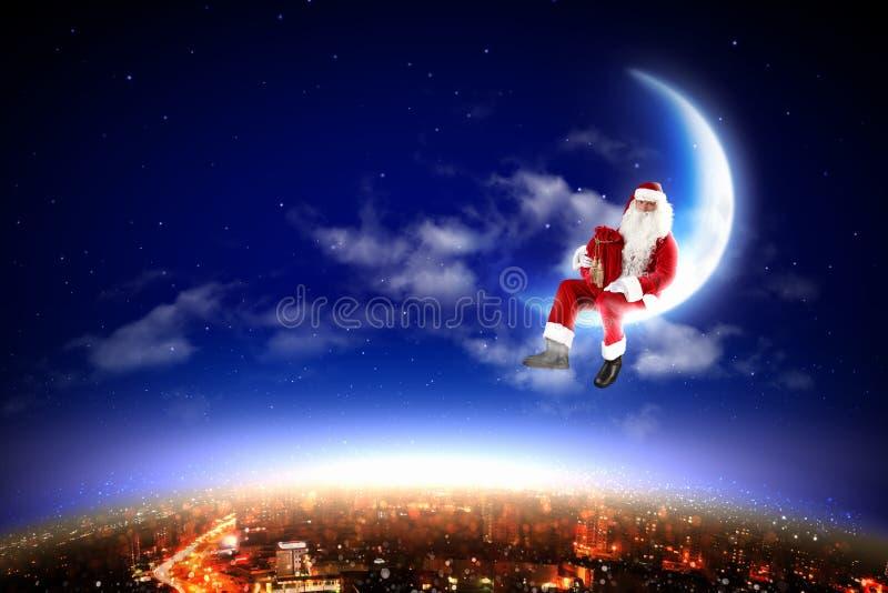 Santa on the moon royalty free stock photo