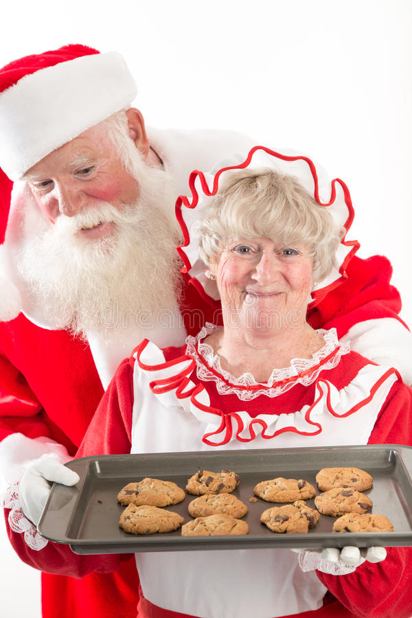 Santa claus and Mrs Santa with cookies royalty free stock image