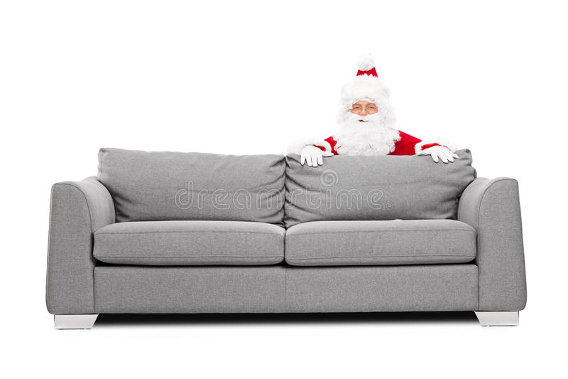 Santa Claus nederlag bak en soffa arkivfoton