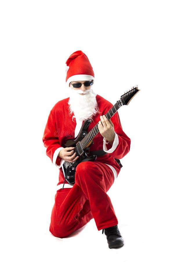 Santa Claus nova com uma E-guitarra fotografia de stock
