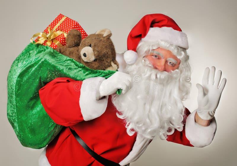 Santa Claus och gåvapåsen arkivbild