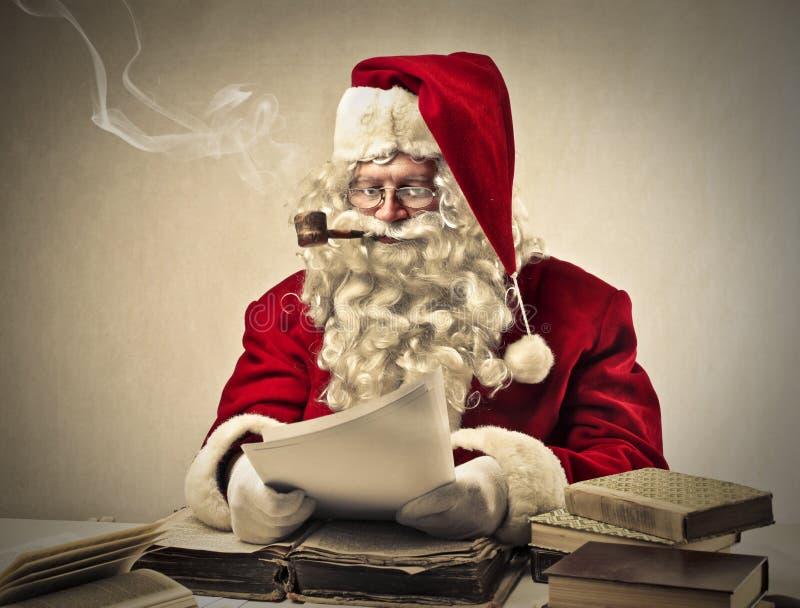 Santa Claus ocupada imagem de stock
