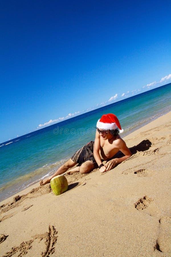 Santa Claus op Caraïbisch strand royalty-vrije stock foto