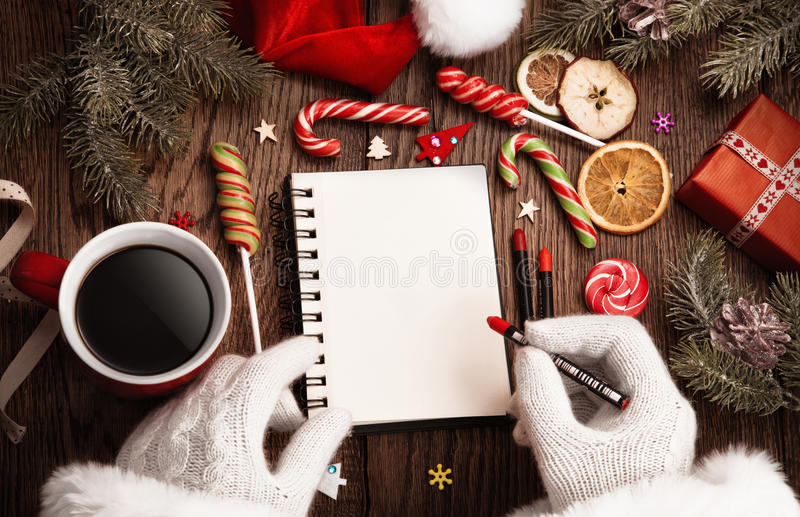 Download Santa Claus With Open Notepad Stock Photo - Image of table, objects: 81100774