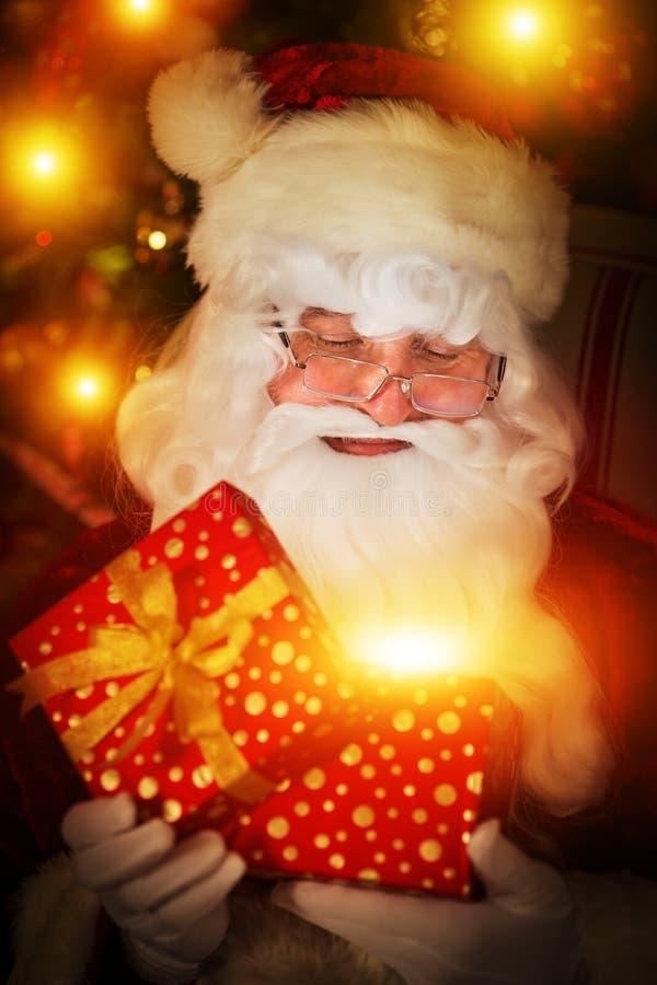Santa Claus. Opening gift box. Christmas holiday concept. Xmas present stock images