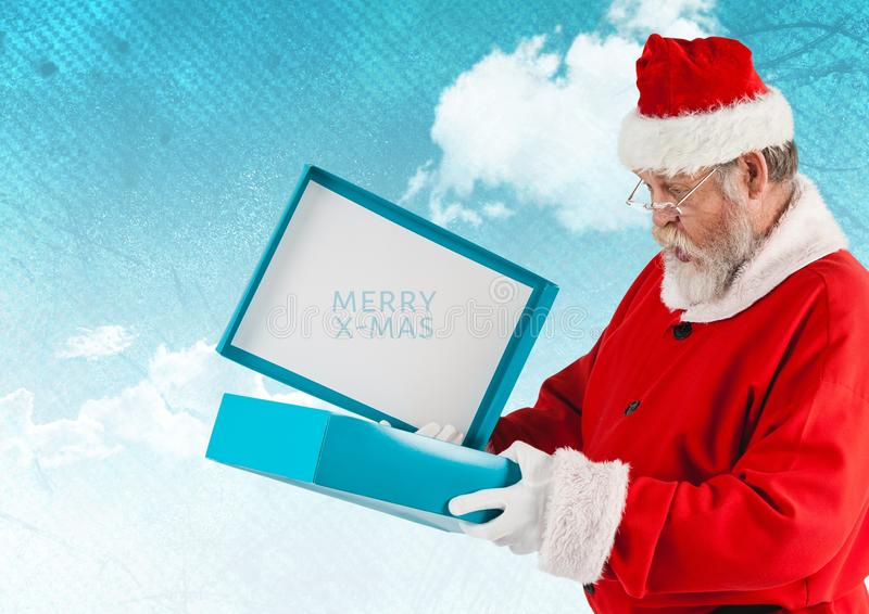 Santa claus opening a gift box. Santa claus opening and looking in to a gift box royalty free stock photo