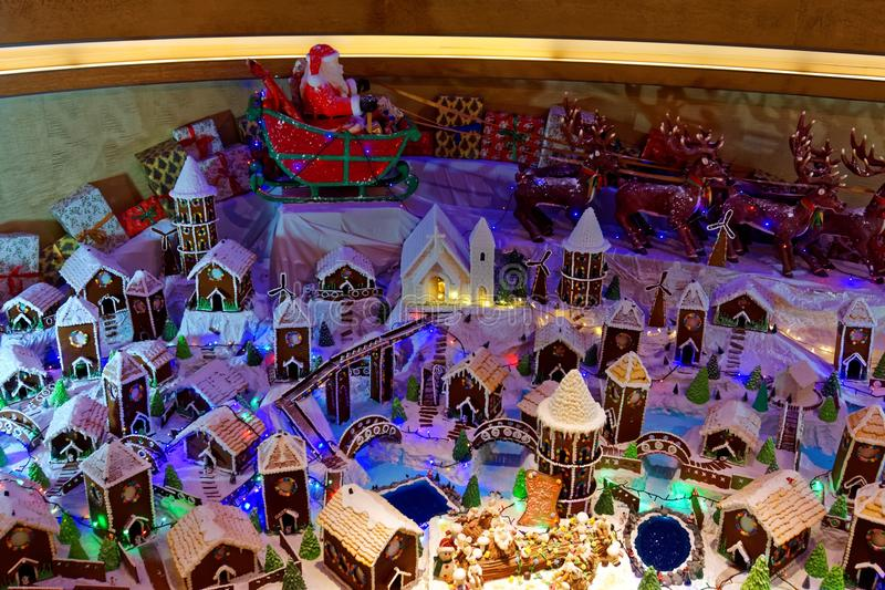 Santa Claus over a Gingerbread Village royalty free stock images
