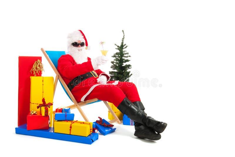 Santa Claus på semester fotografering för bildbyråer