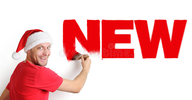 Santa Claus paints the text with a brush stock image