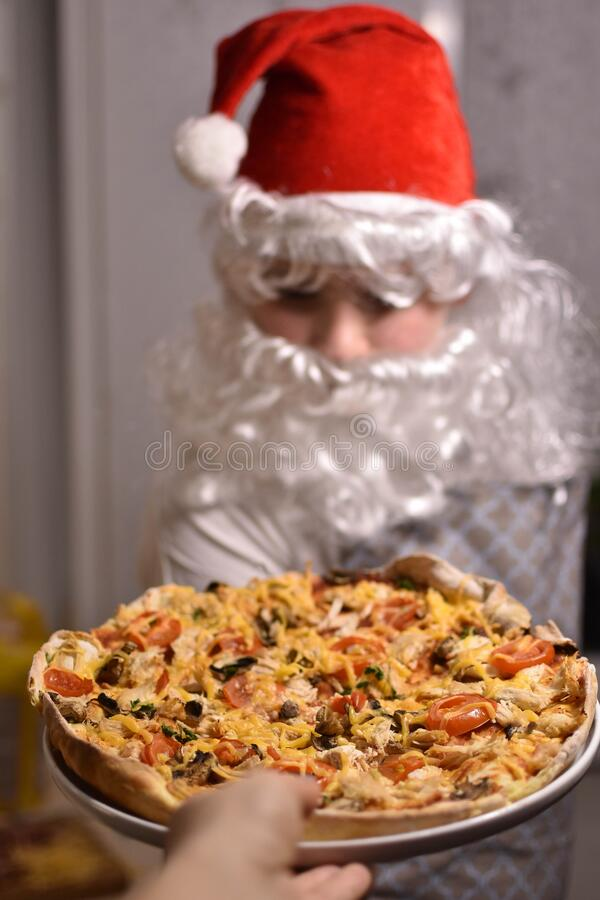 Santa Claus pizza, Christmas pizzaHome-made pizza, ingredients for pizza,the dough rolled. Home-made pizza, ingredients for pizza,Pizza with varenou chicken stock images