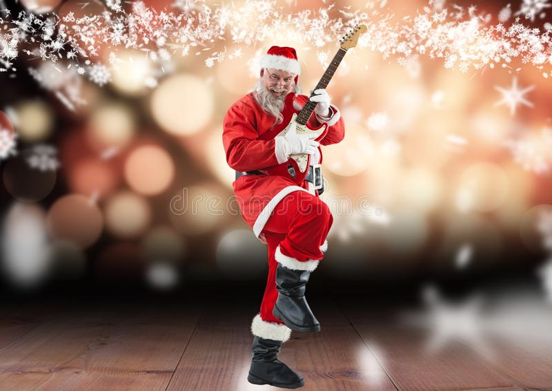 Santa claus playing electric guitar on wooden plank royalty free stock images