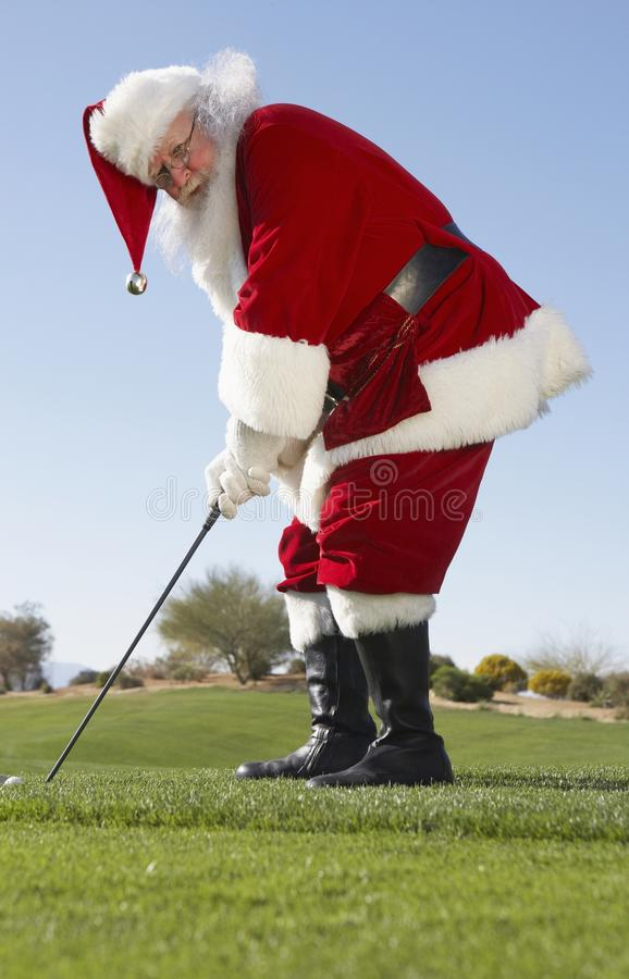 Santa Claus Playing Golf imagens de stock royalty free