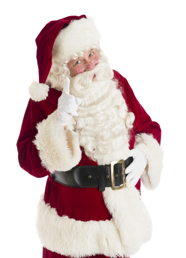 Santa Claus Pointing Against White Background fotos de stock