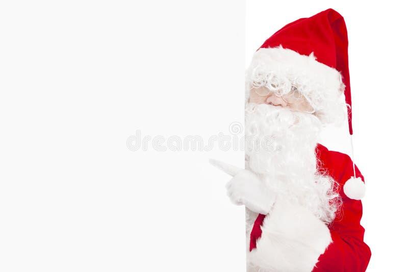 Santa Claus pointing at blank banner. Happy Santa Claus pointing at blank banner stock images