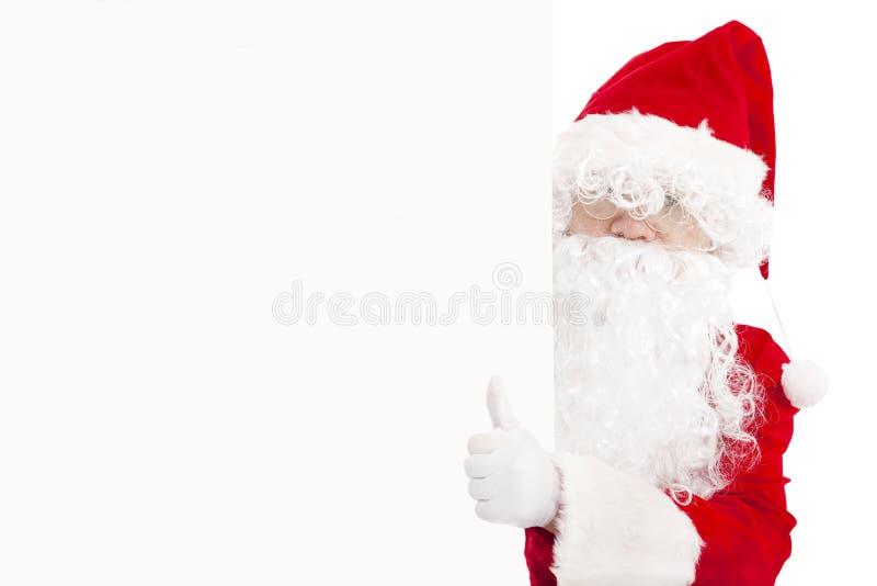 Santa Claus pointing at blank banner with thumb up. Happy Santa Claus pointing at blank banner with thumb up stock image